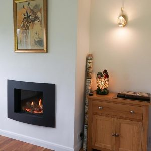 Cosy fire in Dining Room at Clovehayes