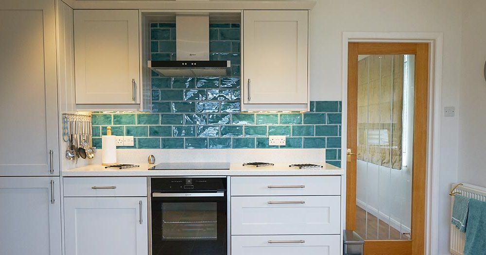 Oven and kitchen worktops at self-catering holiday cottage in North Tawton, Dartmoor.