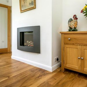 A cosy modern fireplace in Dining Room at Clovehayes Holiday Cottage