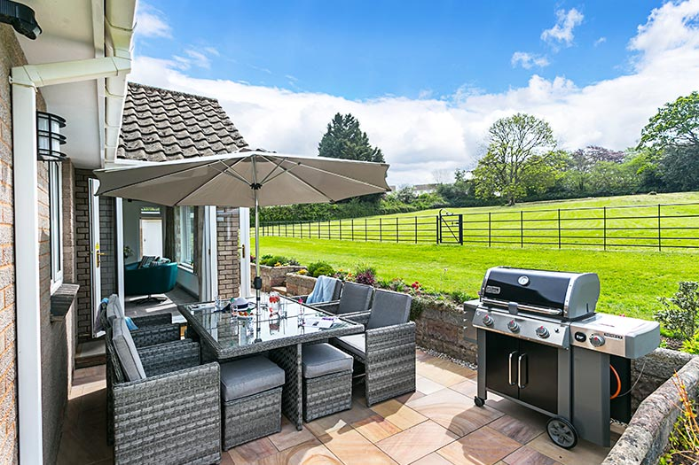 The patio, garden and barbecue at Cloveshayes holiday cottage in Devon is perfect for relaxing
