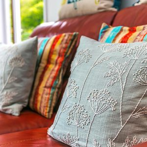 Cushions sat on leather sofa of holiday home in central Devon